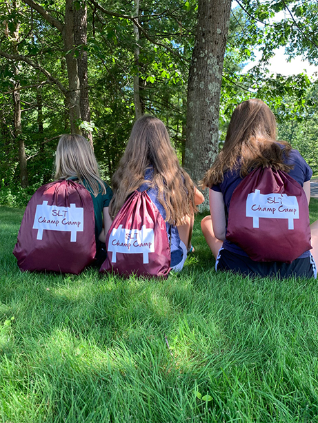 kids with SLT Champ Camp kit